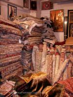 Hundreds of rolled and stacked oriental rugs