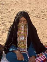 Woman with black robe and headcover, face covered by colorful scarf.
